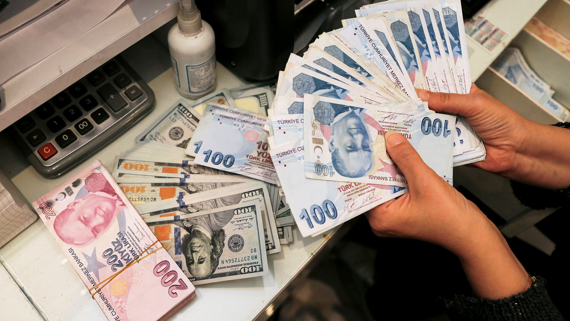 Latest news updates: Turkish lira tumbles to record after Erdogan sacks central bank officials