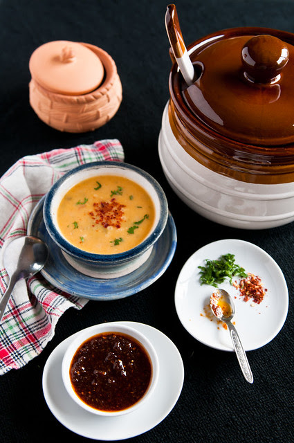 Butternut squash soup with roasted red chile sauce
