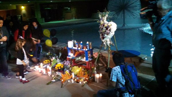 Flowers, candles and other items are placed near the Lyman Lough fountain at CSULB's Brotman Hall...in honor of Nohemi Gonzalez on November 15, 2015.