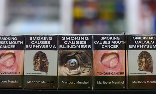 Australia wins international legal battle with Philip Morris over plain packaging