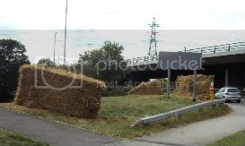 hay bales,A road,pylons,pavements