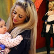 Have a holly Dolly Christmas! Chantelle Houghton braves Lakeside on Xmas Eve as she takes baby daughter to meet Santa
