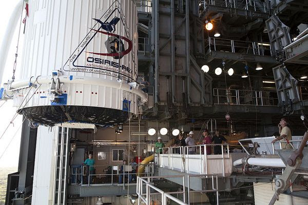 At Space Launch Complex 41 at Cape Canaveral Air Force Station in Florida, the payload fairing containing NASA's OSIRIS-REx spacecraft is hoisted inside the Vertical Integration Facility to be mated with its Atlas V rocket...on August 29, 2016.