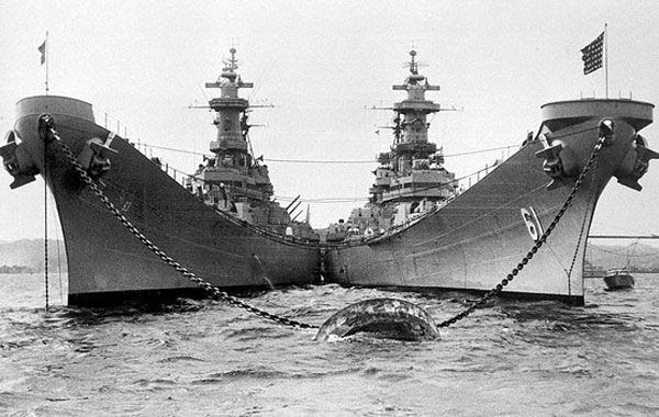 The USS Missouri (BB-63, left) is docked alongside her sister ship USS Iowa (BB-61, right) in this World War II-era photo.