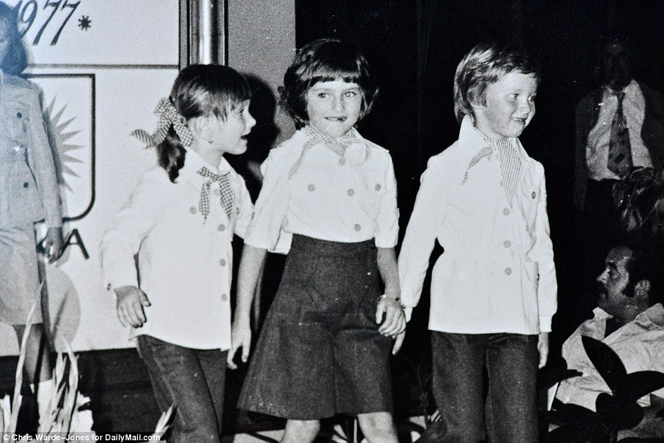 The way she was: A picture taken during a child fashion show shows Melania Knavs in the center with her friend Nena Bedek and sister Ines. The two, and other children, would take part in fashion shows organized by their parents