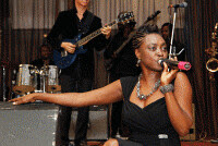 Nigerian artist Elfreda Yinka Davies performing on the set. The musician was featured in a lengthy article in the Guardian newspaper. by Pan-African News Wire File Photos