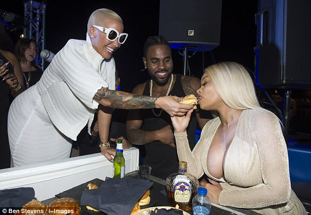Giggling: Amber and Chyna were laughing as a giggling Jason Derulo looked on
