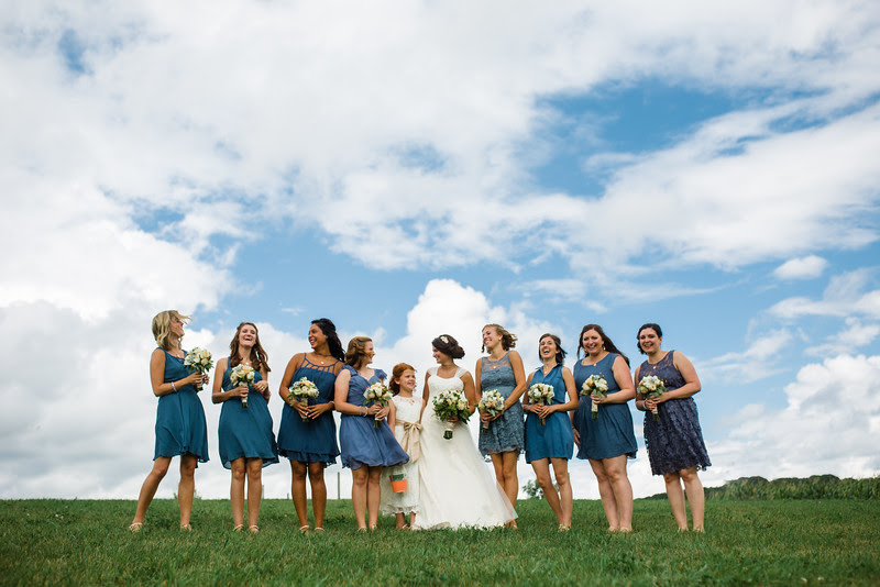 Bride and groom have photos with the wedding party at Busy Barns Adventure farms before a wedding at Busy Barns Adventure Farms in Fort Atkinson Wisconsin about 30 minutes east of Madison and an hour north of Chicago. Photo by Mindy Joy Photography.
