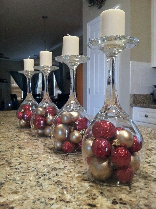 Upside down wine glasses. Ornaments, shiny basket filling with beads, wine corks, flowers, etc. Use for candle, holders, place card holder, food label cards.