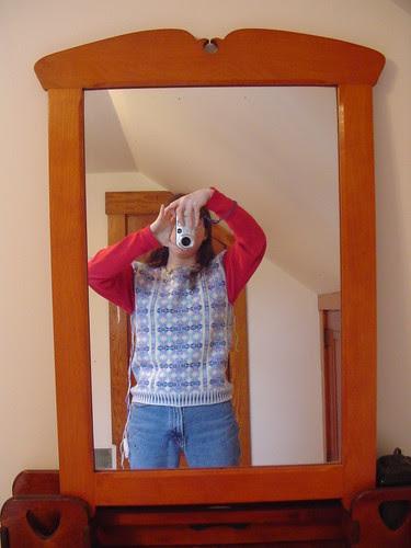 VS sweater doing a vest impression