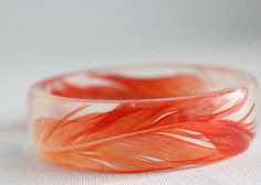love it!!  //  Red African Grey parrot feather round eco resin bracelet by RosellaResin