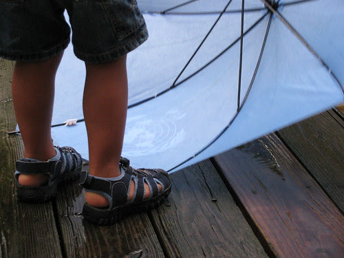 feet and umbrella