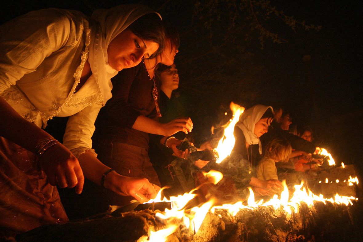 Yazidi women light candles and torches outside Lalesh temple during a ceremony to celebrate the Yazidi New Year, on 17 April 2007