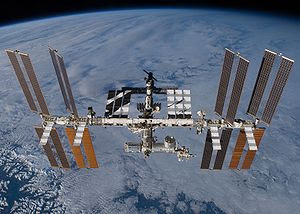The International Space Station as seen in its...