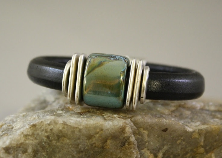 Black Regaliz Leather Bracelet with ceramic focal bead. $45.00, via Etsy.