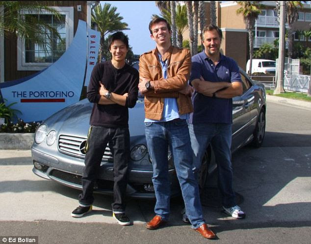 Proud: Ed Bolian (center) is now the holder of fastest man to drive from New York to Los Angeles at his sides are his co-pilot Dave Black (right) and Dan Huang (left)