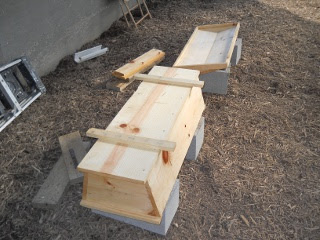 Homemade Top Bar Bee Hive Underside Painting with Water Sealer