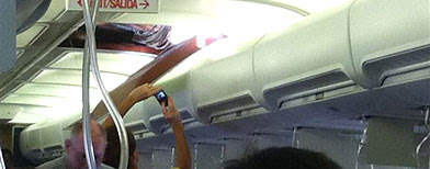 In this photo provided by passenger Christine Ziegler, passengers take photos of a hole in the cabin on a Southwest Airlines plane Friday, April 1, 2011 in Yuma, Ariz. (AP photo/Christine Ziegler)