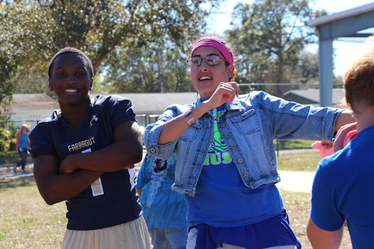 Drill and Football teams give back at Nina Harris Center for Exceptional Children - Admiral Farragut Academy
