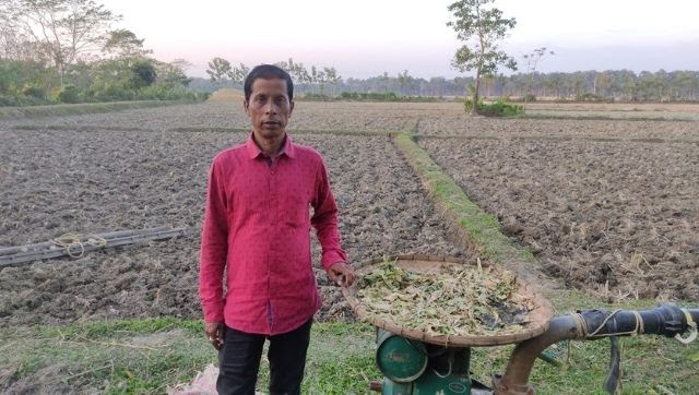 Tapan Chikbaraik in front of his fields [image by: Gurvinder Singh]