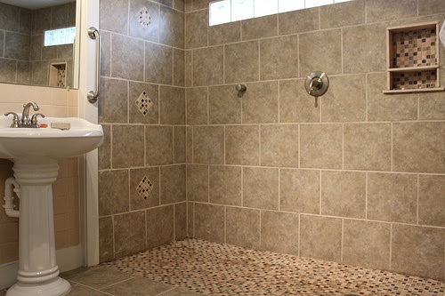 YES! A shower with no door,no curb and no curtain...just walk in!