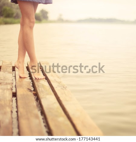 beautiful legs girl on the pier