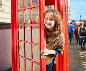 young woman london red phonebooth getty_300x250
