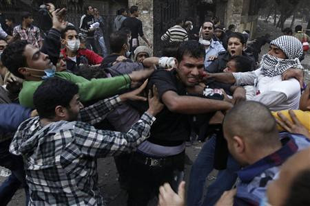 Egyptians clash with security personnel near the US embassy in Cairo. Thousands demonstrated in November 2012 against repression and dictatorship. by Pan-African News Wire File Photos