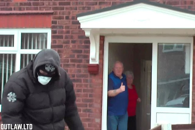 Masked activist handing out free cannabis, toilet paper and hand sanitiser