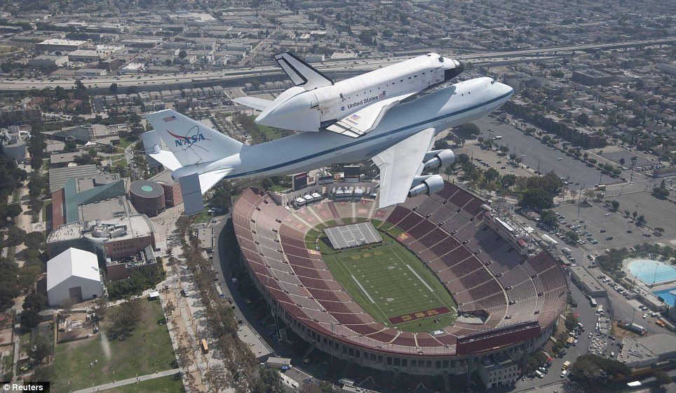 Vista: Endeavour, mounted on a 747, flies over the Los Angeles Memorial Coliseum on Saturday afternoon