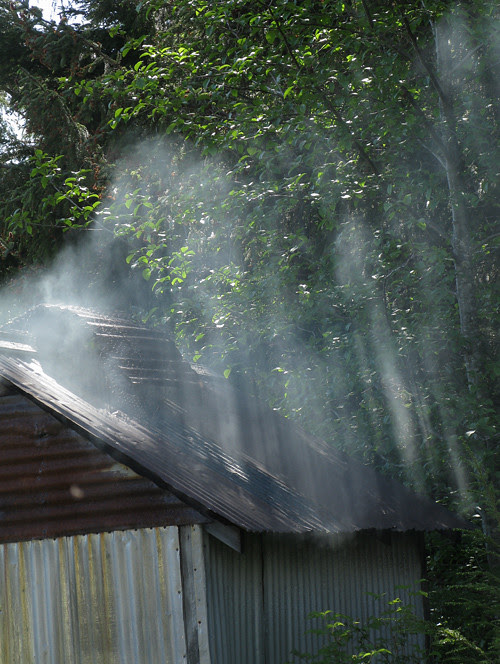 light hits smoke from a Kasaan smokehouse, Alaska