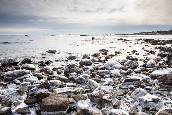 rocks sheathed in ice along the New Hampshire coast