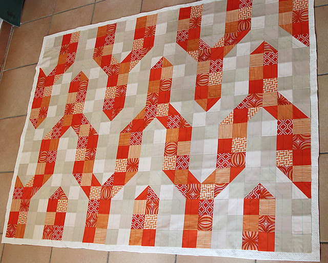 Drawing the quilting pattern on the quilt top with water soluble marker