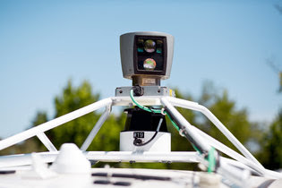A roof-mounted camera on a Google autonomous car.