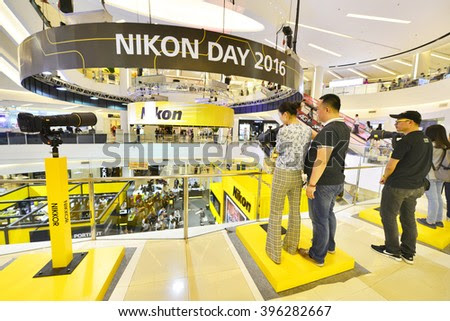 BANGKOK - MARCH25: Shoppers visit Nikon booths at Siam Paragon shopping mall on March 25, 2016 in Bangkok, Thailand. Nikon has a heavy presence in Thailand, both in sales and manufacturing facilities. - stock photo