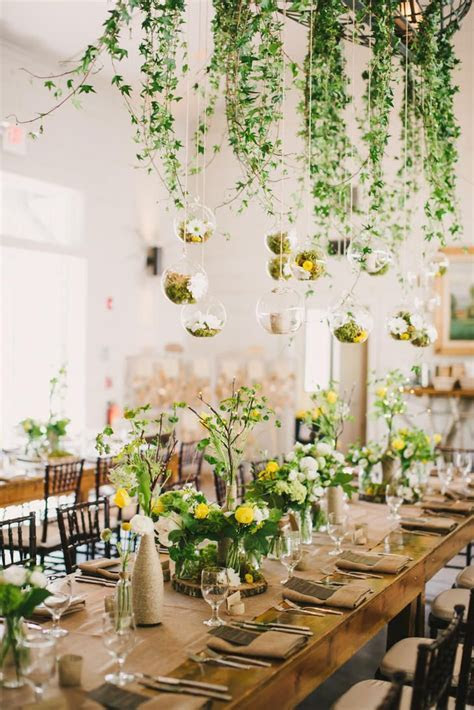 Whimsical suspended moss and ivy centerpieces are perfect