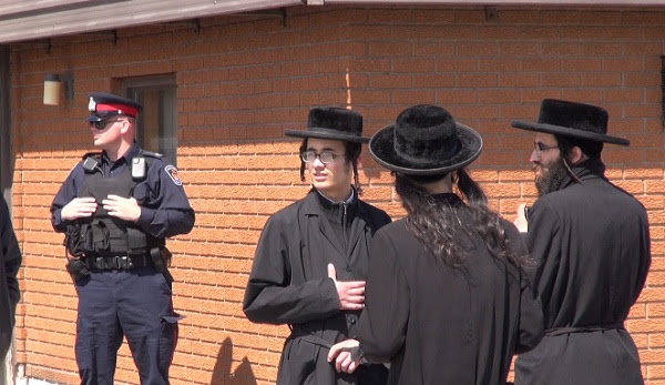 A Chatham-Kent police officer stands guard at the Lev Tahor community north of Chatham. Photo taken on April 2, 2014 by Ashton Patis.