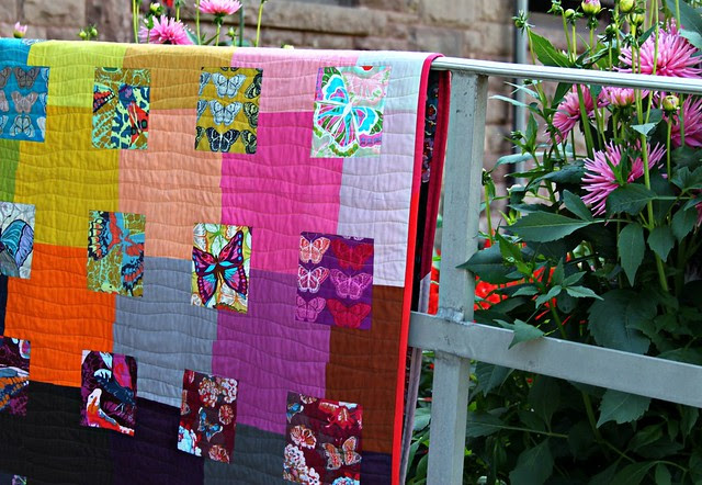 A Butterfly Quilt -- Wavy Quilting and Pink/Red Scrappy Binding