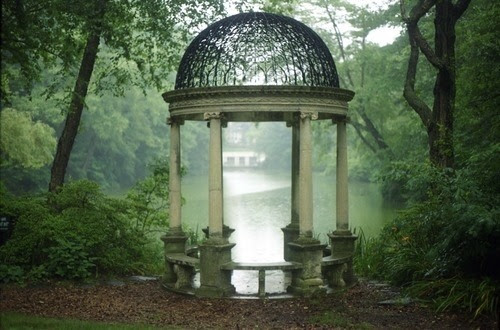 The scene looks peaceful and serene. I could close my eyes and feel myself sitting there in the shade of the trees. I could hear crickets chirping and fish jumping in the pond. Close your eyes and join me.
