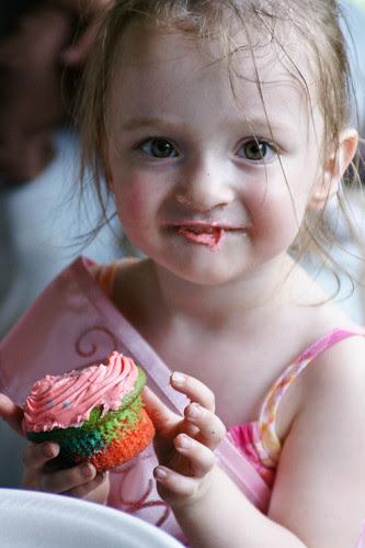 Olivia likes her cupcake