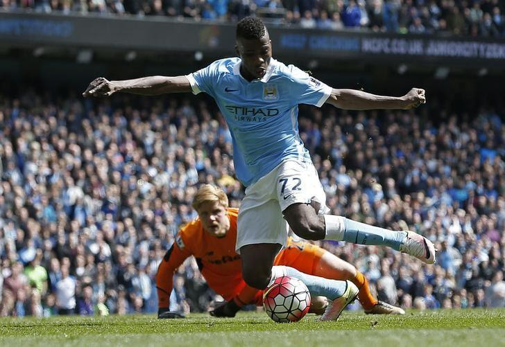 Football Soccer - Manchester City v Stoke City - Barclays Premier League - Etihad Stadium - 23/4/16Kelechi Iheanacho rounds Stoke's Jakob Haugaard to score the fourth goal for Manchester CityReuters / Andrew YatesLivepic