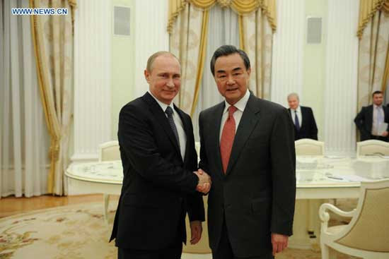 Russian President Vladimir Putin (L) meets with visiting Chinese Foreign Minister Wang Yi in Moscow, Russia, on April 7, 2015. China and Russia will work together to deepen their comprehensive strategic partnership in order to promote the development of both countries and contribute to a lasting world peace. (Xinhua/Dai Tianfang)
