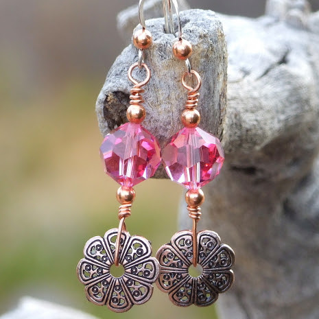 One of a kind copper filigree flower and pink Swarovski crystal earrings.