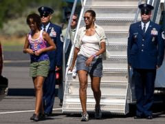 PHOTO: This Aug. 16, 2009 file photo shows first lady Michelle Obama and daughter Malia Obama, walking off Air Force One at Grand Canyon National Park Airport in Tusayan, Ariz.
