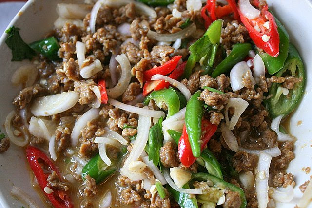 Mixture of cooked minced beef, raw onions, sliced onions, red and green chilies in egg