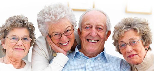 [Photo of smiling older people]