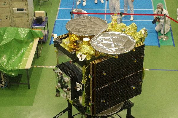 JAXA's asteroid-bound Hayabusa 2 spacecraft is unveiled during a special event at the Samagihara spacecraft assembly facility in Japan, on August 31, 2014.