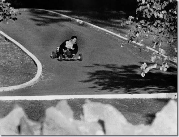 Elvis Presley on a go cart racing up the driveway of Graceland | October 12, 1965