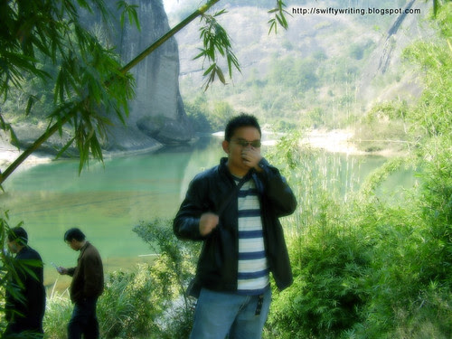 Standing In Front Of The River After Climbing Tianyou Peak