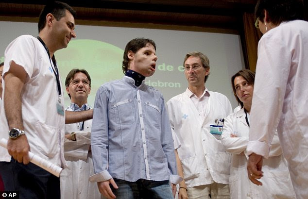 Oscar stands beside Dr Joan Barret, left, and is surrounded by his doctors. He was treated by a team of 30 specialised medics